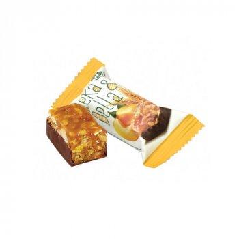 Мюсли-конфеты с кусочками кураги, арахиса и злаки Deka Della курага-злаки Лукас ящик 2,5 кг